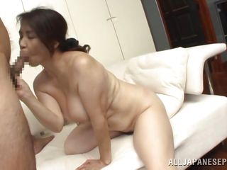 brunette mature opens wide then bends over