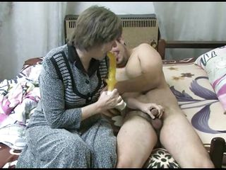 old nanny sucks on a sex toy and a cock