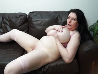 horny milf sabrina caresses her huge boobs and plump cunt