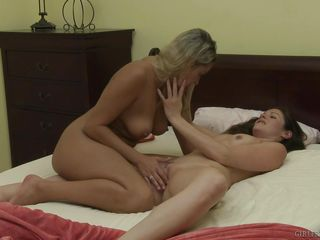 two babes fooling around passionately