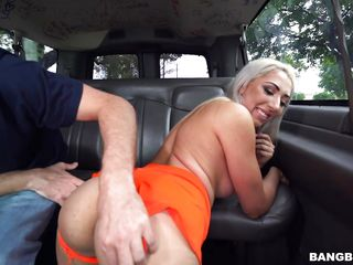 busty blonde gets rammed in the back seat