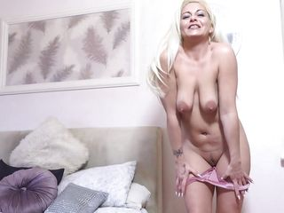 beautiful mature blonde strips and plays for the camera